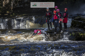 Activity adventure group during canyoning in Wales