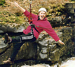 Adventure activity holiday with girl on a tyrolean crossing a river